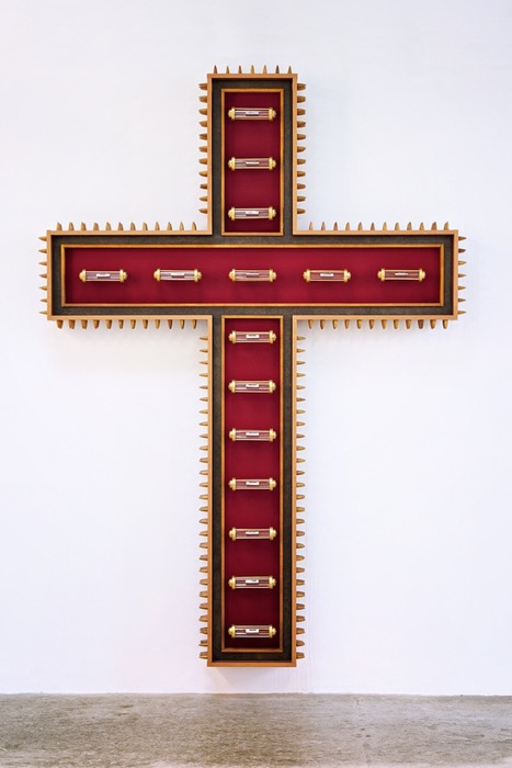 150 years of Indulgence a spear laden cross with 15 reliquaries displayed within