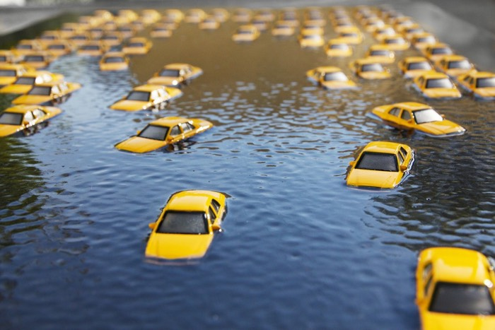 Taxis submerged in flood